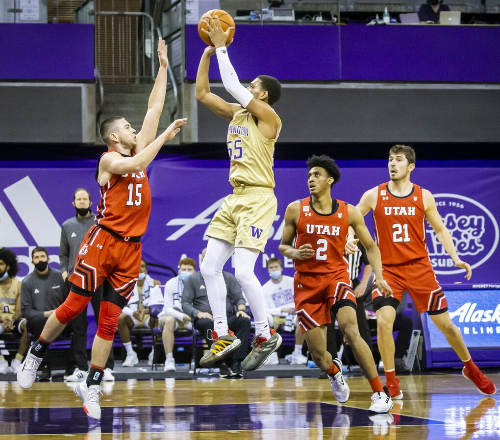 Washington guard Quade Green hits a jumper over Utah guard Rylan Jones in the second half for two of his game-leading 28 points as the University of Washington Huskies take on the Utah Utes at Alaska Airlines Arena Sunday January 24, 2021.  (Bettina Hansen / The Seattle Times)