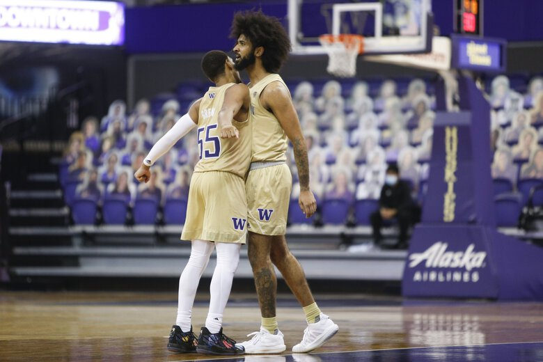 Washington's Marcus Tsohonis, right, celebrates with Quade Green after making a 3-pointer against Colorado during the second half of an NCAA college basketball game Wednesday, Jan. 20, 2021, in Seattle. (Joe Nicholson / The Associated Press)