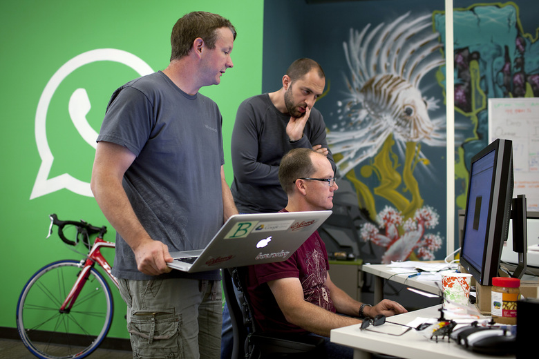 From left, WhatsApp founders Brian Acton and Jan Koum work with Rick Reed, a software engineer, at the company's headquarters in Mountain View, Calif., in 2013. WhatsApp said on Friday that it would delay a planned privacy update, as the Facebook-owned messaging service tries to stem an exodus of users worried about the changes. (Peter DaSilva/The New York Times)
