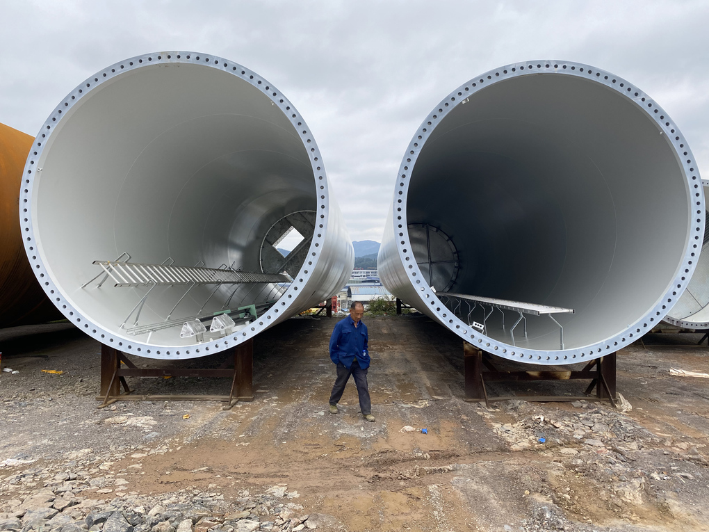 Towers for wind turbines at a factory in the farming town of Changmingzhen, China, on Oct. 28, 2020. The town's boom stems from government projects and the new Laoganma factory, which makes a spicy sauce famous across China. (Keith Bradsher / The New York Times)