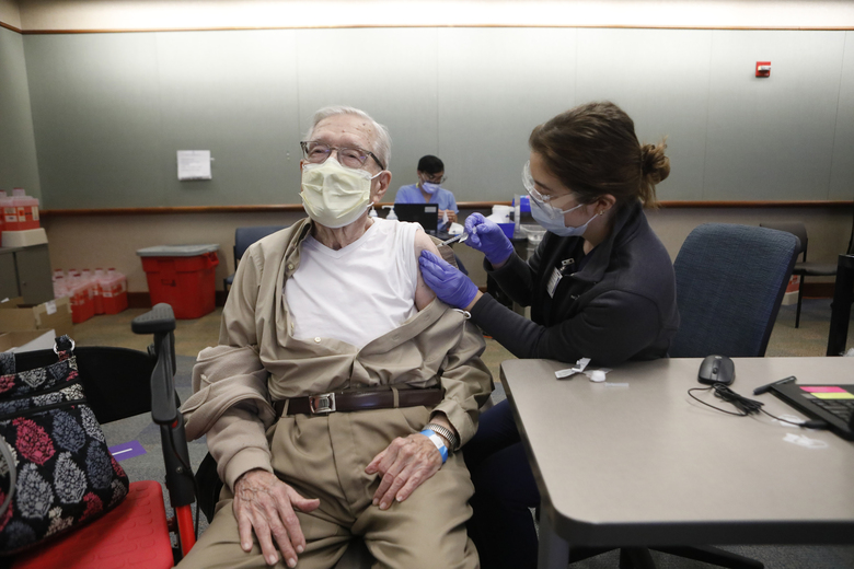 Joseph Riordan, receives a COVID-19 vaccination from Corinne Felix at the HealthPartners medical campus in Minneapolis last week. Demand for vaccines is skyrocketing as the United States copes with a record death toll from COVID-19 and the threat of new, more contagious variants. (Octavio Jones / The New York Times file)