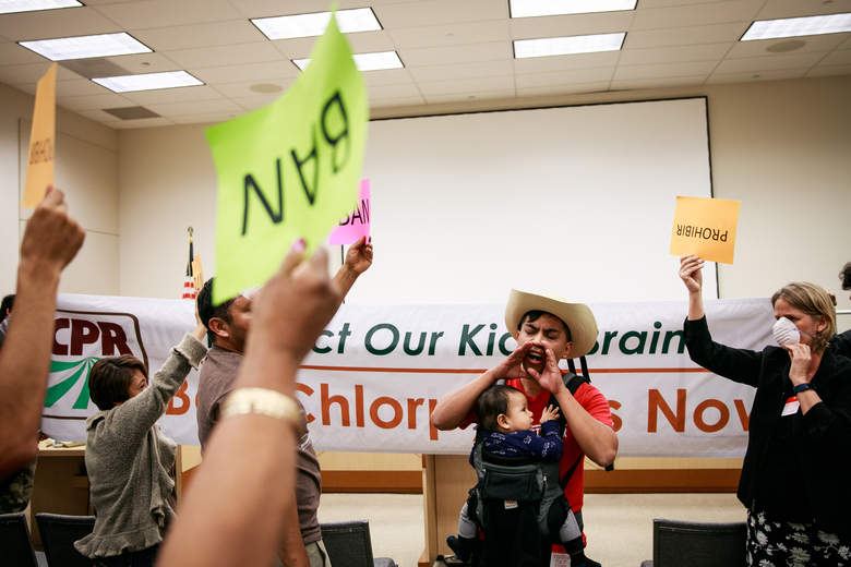Protesters at the California Environmental Protection Agency headquarters after a public hearing on increasing restrictions on the use of the agricultural pesticide chlorpyrifos, in Sacramento, Calif., on Nov. 8, 2018. The EPA has finalized a so-called transparency plan that it says will improve the credibility of science. Scientists say it is designed to stop new public health protections by limiting what research the agency can consider. (Max Whittaker/The New York Times)