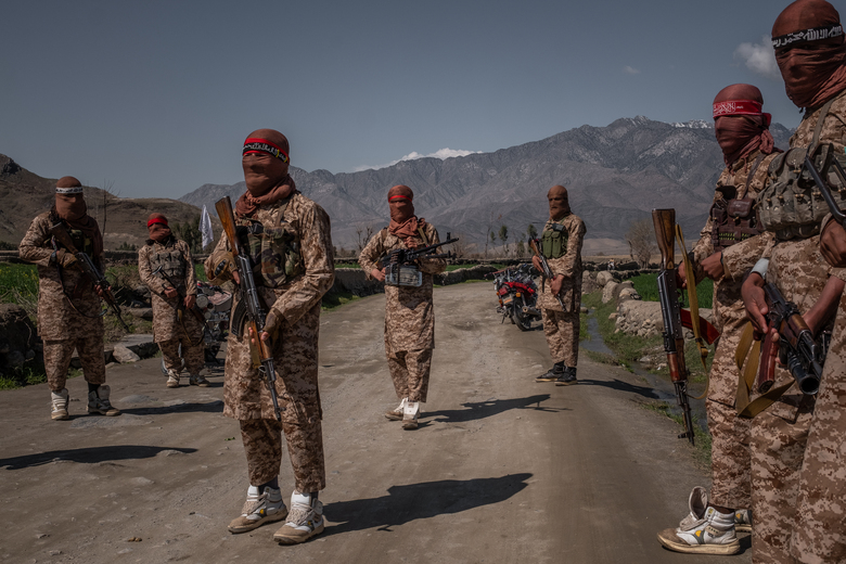Members of the Taliban's elite 'Red Unit' wear high-top white sneakers with green-and-yellow trim in Laghman, Afghanistan, March 13, 2020. Called Cheetahs and made in Pakistan by Servis Shoes, the unassuming high-tops have been favored by insurgents for decades, so much that they have become synonymous with violence, and the Taliban in particular. (Jim Huylebroek/The New York Times) ..