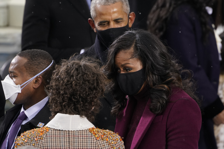 Former President Barack Obama and his wife Michelle talk with Ella Emhoff as they arrive for the 59th Presidential Inauguration at the U.S. Capitol for President-elect Joe Biden in Washington, Wednesday, Jan. 20, 2021. (AP Photo/Andrew Harnik)