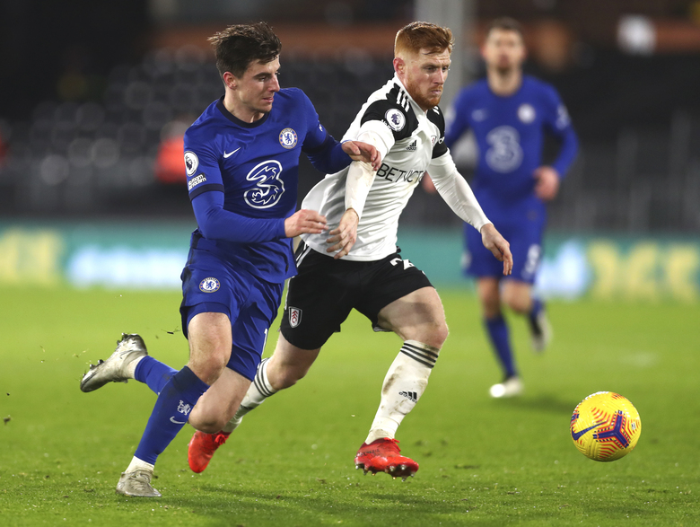 Chelsea's Mason Mount, left, and Fulham's Harrison Reed challenge for the ball during the English Premier League soccer match between Fulham and Chelsea at Craven Cottage in London, England, Saturday, Jan. 16, 2021. (Clive Rose/Pool via AP)