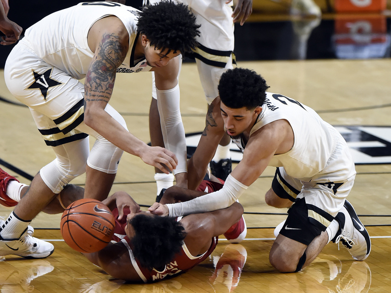 Vanderbilt forward Myles Stute, left, and guard Scotty Pippen Jr. (2) fight for the ball with Arkansas guard Moses Moody (5) during the second half of an NCAA college basketball game against Vanderbilt Saturday, Jan. 23, 2021, in Nashville, Tenn. Arkansas won 92-71. (AP Photo/Mark Zaleski)