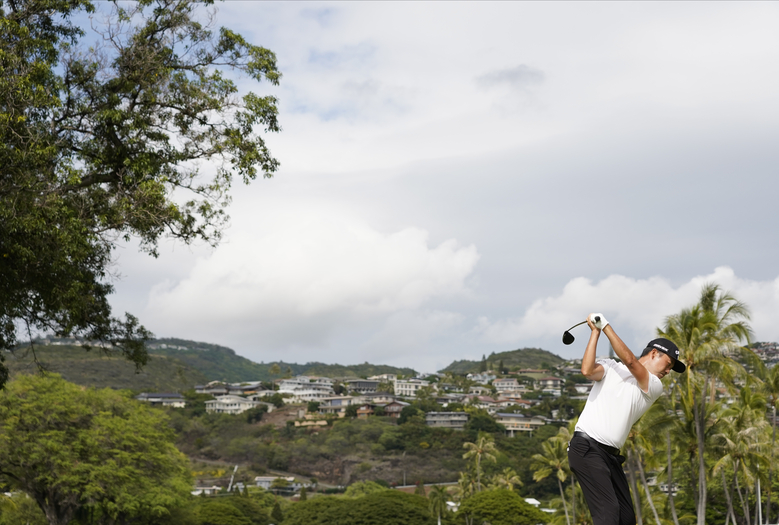 Kevin Na hits from the 14th tee during the final round of the Sony Open golf tournament Sunday, Jan. 17, 2021, at Waialae Country Club in Honolulu. (Jamm Aquino/Honolulu Star-Advertiser via AP)