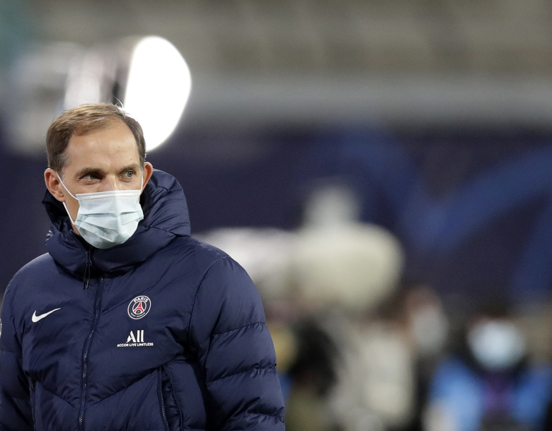 FILE – In this file photo dated Wednesday, Nov. 4, 2020, PSG's head coach Thomas Tuchel looks on during warm up before the Champions League group H soccer match against RB Leipzig at the RB Arena in Leipzig, Germany. Thomas Tuchel is confirmed as the new Chelsea soccer team manager, Tuesday Jan. 26, 2021.(AP Photo/Michael Sohn, FILE)