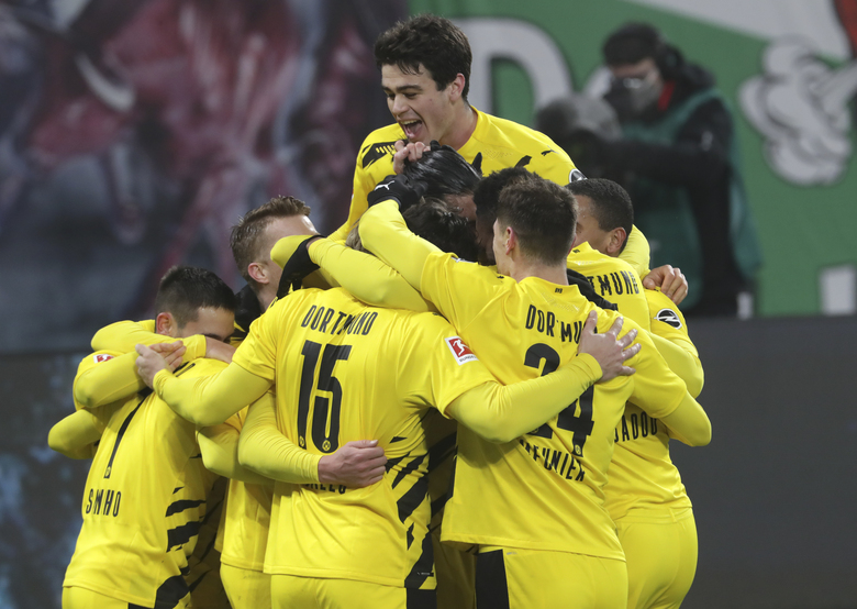Dortmund players celebrate after Dortmund's Erling Haaland scored his side's second goal during the German Bundesliga soccer match between RB Leipzig and Borussia Dortmund in Leipzig, Germany, Saturday, Jan. 9, 2021. (AP Photo/Michael Sohn)