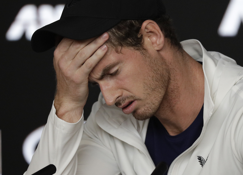 FILE – In this Tuesday, Jan. 15, 2019 file photo Britain's Andy Murray reacts during a press conference following his first round loss to Spain's Roberto Bautista Agut at the Australian Open tennis championships in Melbourne, Australia. Former world number one Murray's participation at the upcoming Australian Open is in doubt after the Briton tested positive for COVID-19. (AP Photo/Kin Cheung, File)