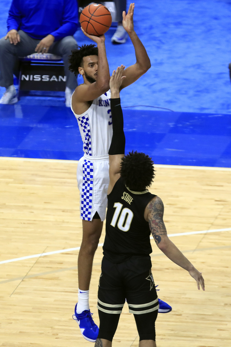 Kentucky's Olivier Sarr, top, shoots while pressured by Vanderbilt's Myles Stute (10) during the second half of an NCAA college basketball game in Lexington, Ky., Tuesday, Jan. 5, 2021. Kentucky won 77-74. (AP Photo/James Crisp)