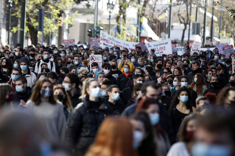 University students gather during a rally against educational reforms in Athens, Thursday, Jan. 21, 2021. About 1,500 students took part in two separate protests against government's plans to set up a state security division at university campuses and time limits set for the completion of degree courses. (Thanassis Stavrakis / The Associated Press)