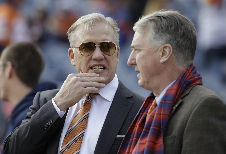 """FILE – In this Sunday, Jan. 1, 2017 file photo, Denver Broncos general manager John Elway, left, stands with Broncos President and CEO Joe Ellis, right, before an NFL football game against the Oakland Raiders in Denver. The Denver Broncos' new general manager will join an organization embroiled in a family ownership feud and will work in the shadow of John Elway, whom team president Joe Ellis described as """"the most important and impactful person"""" in franchise history.(AP Photo/Jack Dempsey, File)"""