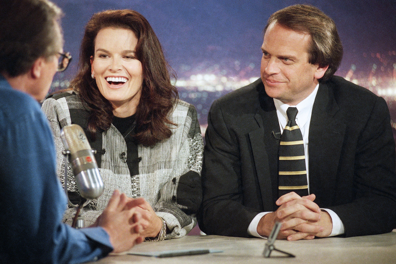 FILE – In this Feb. 10, 1997 file photo, Denise Brown, sister of murder victim Nicole Brown Simpson, center, and John Q. Kelly, Brown family attorney in the O.J. Simpson civil trial, right, speaks with talk-show host Larry King, left, in Los Angeles hours after jurors assessed Simpson $25 million in punitive damages for the deaths of Nicole Brown Simpson and Ronald Goldman.  King, who interviewed presidents, movie stars and ordinary Joes during a half-century in broadcasting, has died at age 87. Ora Media, the studio and network he co-founded, tweeted that King died Saturday, Jan. 23, 2021 morning at Cedars-Sinai Medical Center in Los Angeles.  (AP Photo/Rene Macura)
