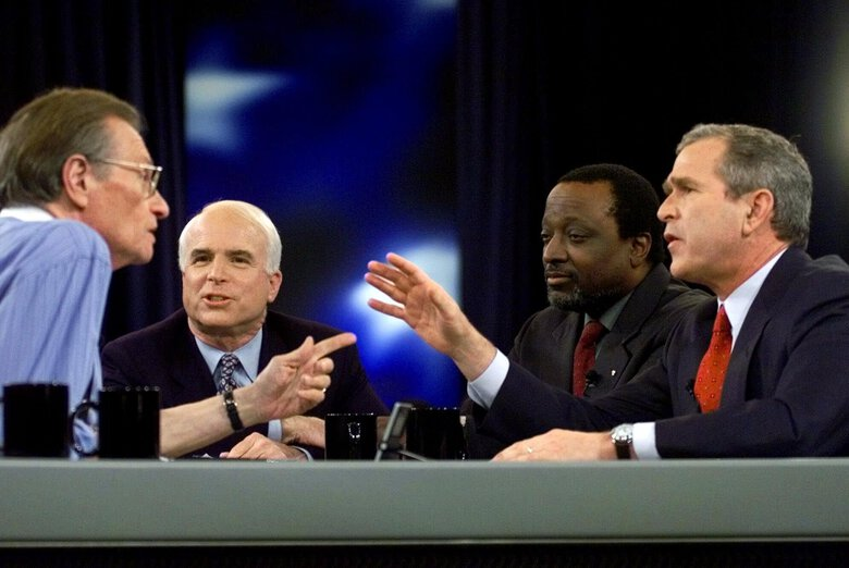 FILE – In this Feb. 15, 2000 file photo, Larry King, host of CNN's Larry King Live, asks a question to the Republican presidential candidates, from left, Sen. John McCain, Alan Keyes, and Gov. George W. Bush of Texas, during the Republican presidential debate in Columbia, S.C.  King, who interviewed presidents, movie stars and ordinary Joes during a half-century in broadcasting, has died at age 87. Ora Media, the studio and network he co-founded, tweeted that King died Saturday, Jan. 23, 2021 morning at Cedars-Sinai Medical Center in Los Angeles.  (AP Photo/Eric Draper, Pool)