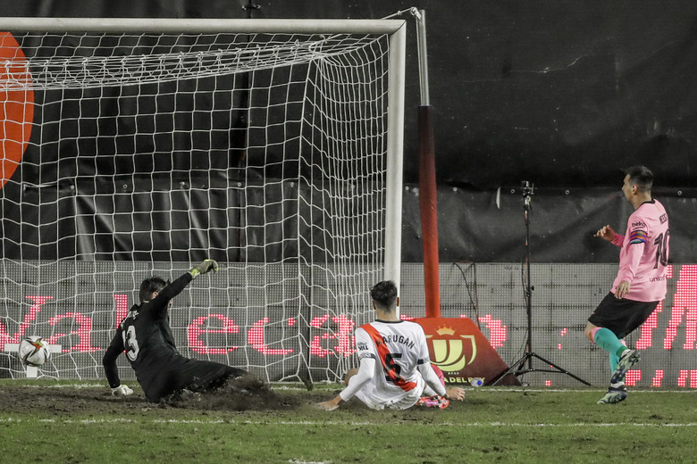 Barcelona's Lionel Messi, right, scores his team first goal during a Spanish Copa del Rey round of 16 soccer match between Rayo Vallecano and FC Barcelona at the Vallecas stadium in Madrid, Spain, Wednesday, Jan. 27, 2021. (AP Photo/Manu Fernandez)