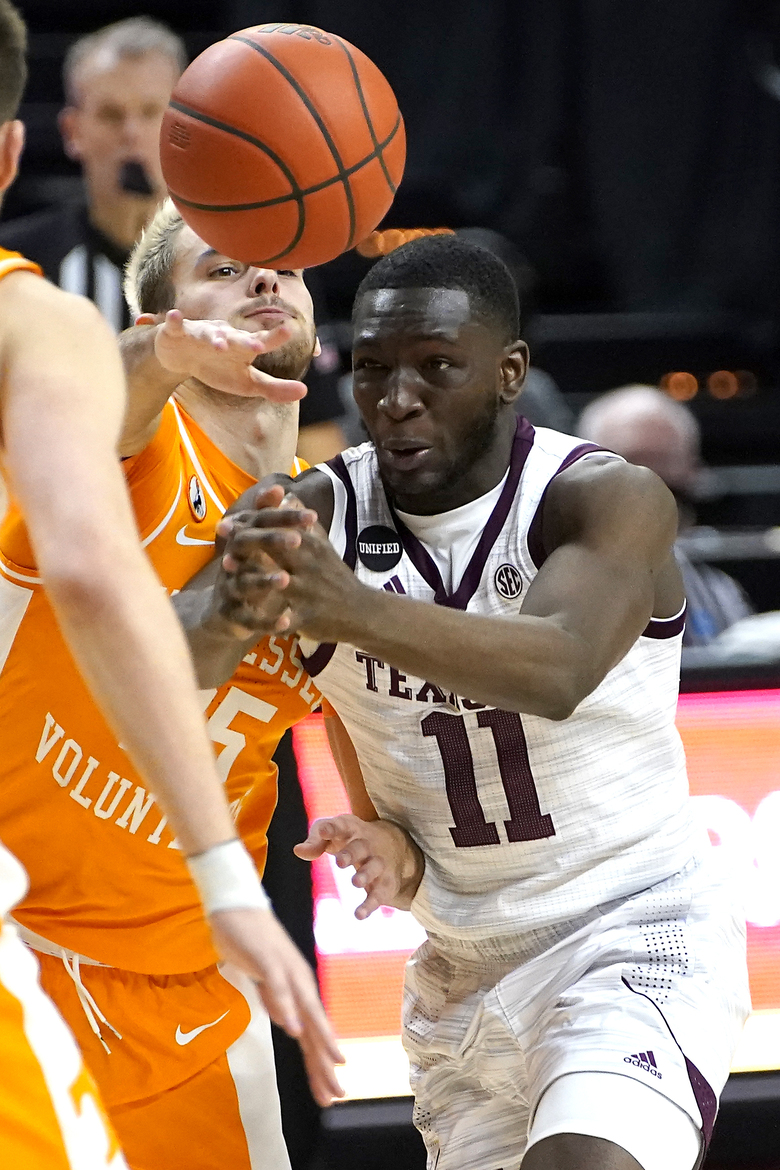 Texas A&M guard Hassan Diarra (11) has the ball knocked away by Tennessee guard Santiago Vescovi (25) while driving to the basket during the second half of an NCAA college basketball game Saturday, Jan. 9, 2021, in College Station, Texas. (AP Photo/Sam Craft)