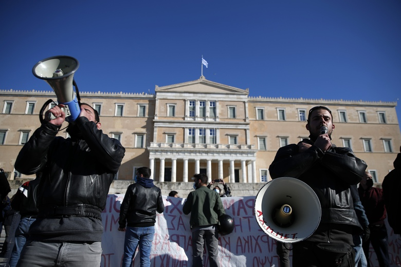 University students use loudspeakers to shout slogans outside the Greek parliament during a rally against education reforms in Athens, Thursday, Jan. 28, 2021. Thousands of protesters in Greece have held demonstrations in the Greek capital and the second largest city of Thessaloniki against proposed education reforms, defying a weeklong public ban on protests imposed as part of measures to tackle the coronavirus pandemic. (AP Photo/Thanassis Stavrakis)