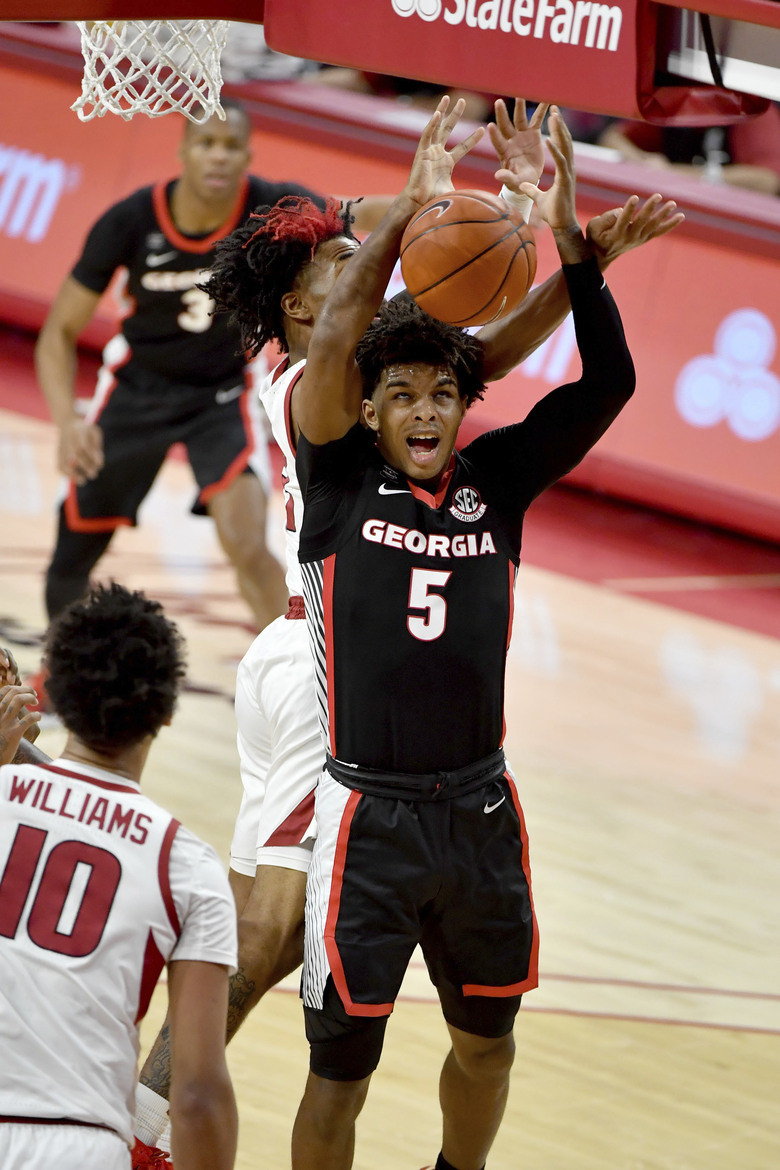 Georgia's Justin Kier (5) drives the hoop against Arkansas during the first half of an NCAA college basketball game Saturday, Jan. 9, 2021, in Fayetteville, Ark. (AP Photo/Michael Woods)