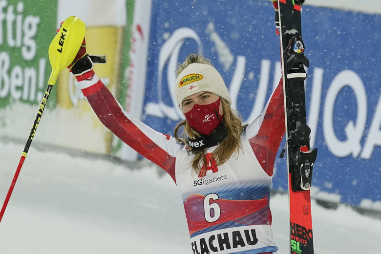 Austria's Katharina Liensberger celebrates her second place in a alpine ski, women's World Cup slalom in Flachau, Austria, Tuesday, Jan. 12, 2021. (AP Photo/Giovanni Auletta)