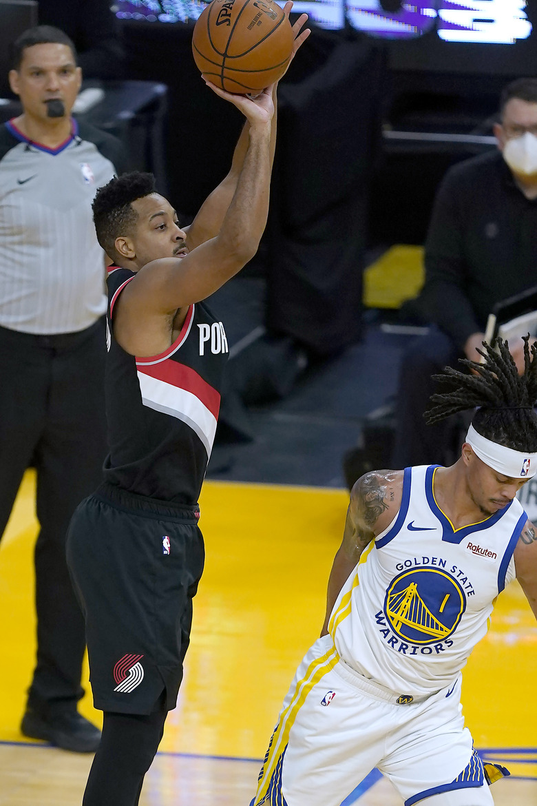Portland Trail Blazers guard CJ McCollum (3) takes a 3-point shot over Golden State Warriors guard Damion Lee (1) during the first half of an NBA basketball game in San Francisco, Friday, Jan. 1, 2021. (AP Photo/Tony Avelar)
