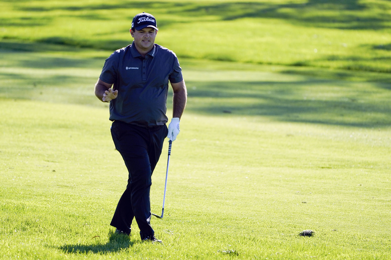 Patrick Reed reacts to fans watching from a nearby hotel after his second shot on the 18th hole of the South Course during the third round of the Farmers Insurance Open golf tournament at Torrey Pines, Saturday, Jan. 30, 2021, in San Diego. (AP Photo/Gregory Bull)