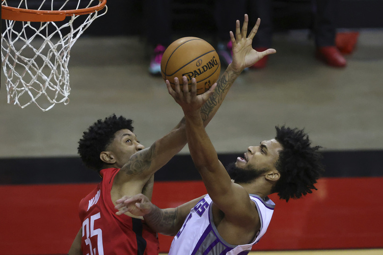 Sacramento Kings' Marvin Bagley III, right, shoots, against Houston Rockets' Christian Wood (35) during the second quarter of an NBA basketball game Saturday, Jan. 2, 2021, in Houston. (Carmen Mandato/Pool Photo via AP)