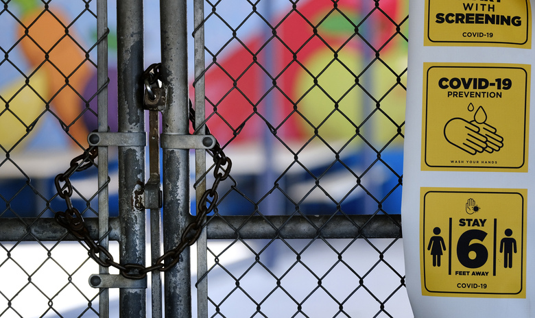 FILE – In this July 13, 2020, file photo, a gate is locked at the closed Ranchito Elementary School in the San Fernando Valley section of Los Angeles. An effort to reopen California schools is foundering, stoking frustrations across America's most populous state from parents eager to get their children back in classrooms and a governor who wants them there.  (AP Photo/Richard Vogel, File)