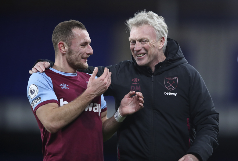 West Ham's manager David Moyes, right, smiles with his player Vladimir Coufal at the end of the English Premier League soccer match between Everton and West Ham at Goodison Park in Liverpool, England, Friday, Jan. 1, 2021. (Alex Pantling, Pool via AP)