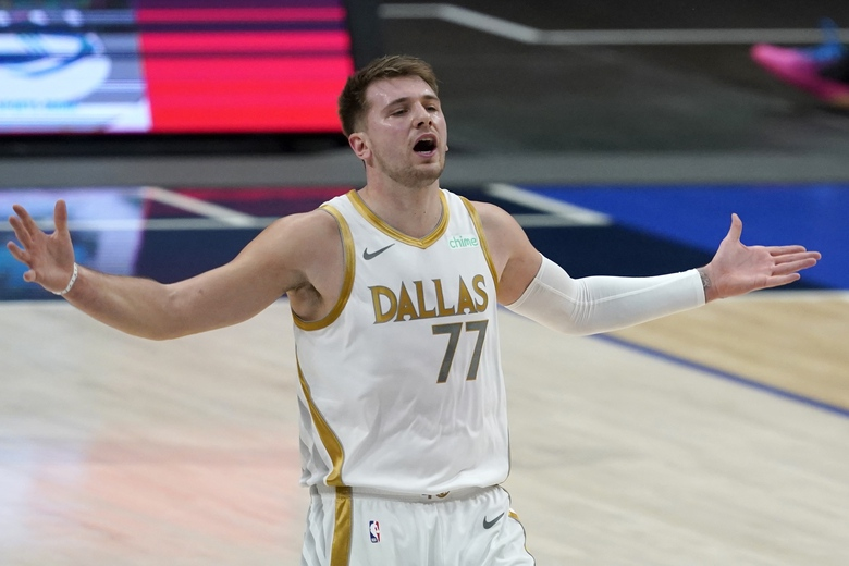 Dallas Mavericks' Luka Doncic (77) gestures after missing on a 3-point shot attempt in the first half of an NBA basketball game against the Denver Nuggets in Dallas, Monday, Jan. 25, 2021. (AP Photo/Tony Gutierrez)