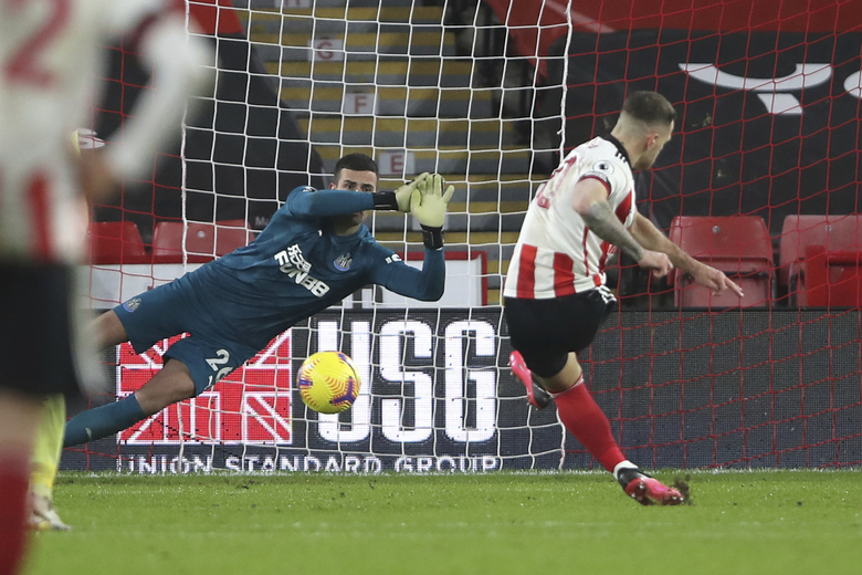 Sheffield United's Billy Sharp scores his side's first goal from the penalty spot during the English Premier League soccer match between Sheffield United and Newcastle United at the Bramall Lane stadium in Sheffield, England, Tuesday, Jan. 12, 2021. (Molly Darlington/Pool via AP)