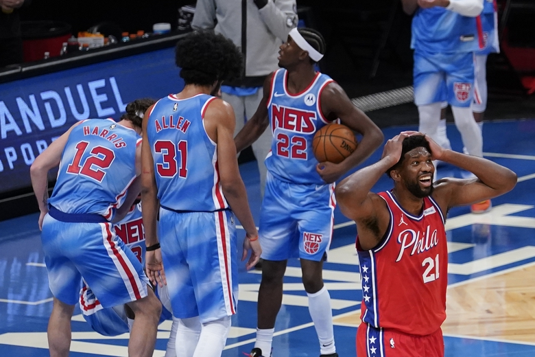 Philadelphia 76ers' Joel Embiid (21) reacts to a foul called on him during the second half of the team's NBA basketball game against the Brooklyn Nets on Thursday, Jan. 7, 2021, in New York. (AP Photo/Frank Franklin II)