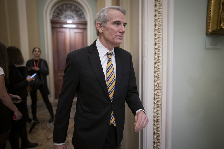 FILE – In this Jan. 31, 2020, file photo Sen. Rob Portman, R-Ohio, arrives as the first impeachment trial of President Donald Trump in Washington. Portman said Monday, Jan. 25, 2021, that he won't seek reelection and plans to end a career in federal government spanning more than three decades. (AP Photo/J. Scott Applewhite, File)