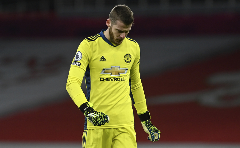 Manchester United's goalkeeper David de Gea reacts during the English Premier League soccer match between Arsenal and Manchester United at the Emirates stadium in London, Saturday, Jan. 30, 2021. (Andy Rain/Pool via AP)