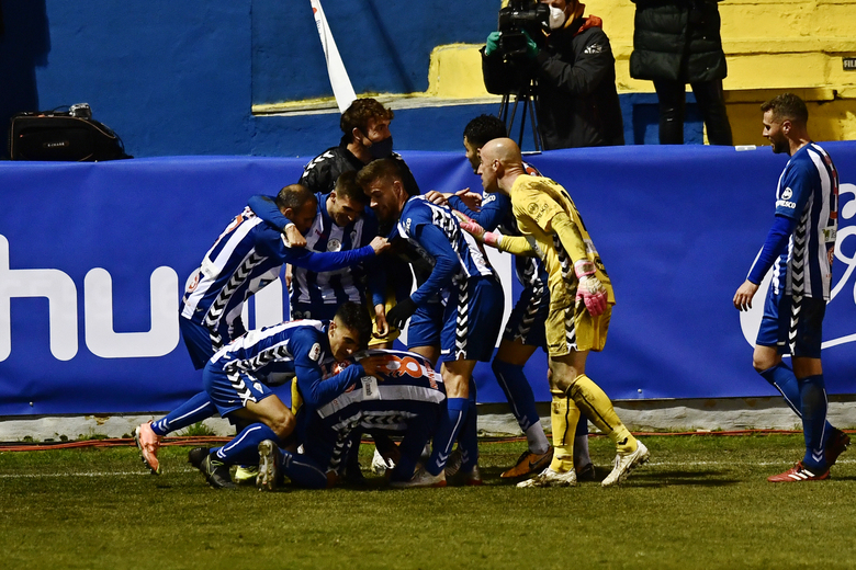 Alcoyano players celebrates after Juanan scored his side's second goal during a Spanish Copa del Rey round of 32 soccer match between Alcoyano and Real Madrid at the El Collao stadium in Alcoy, Spain, Wednesday Jan. 20, 2021. (AP Photo/Jose Breton)