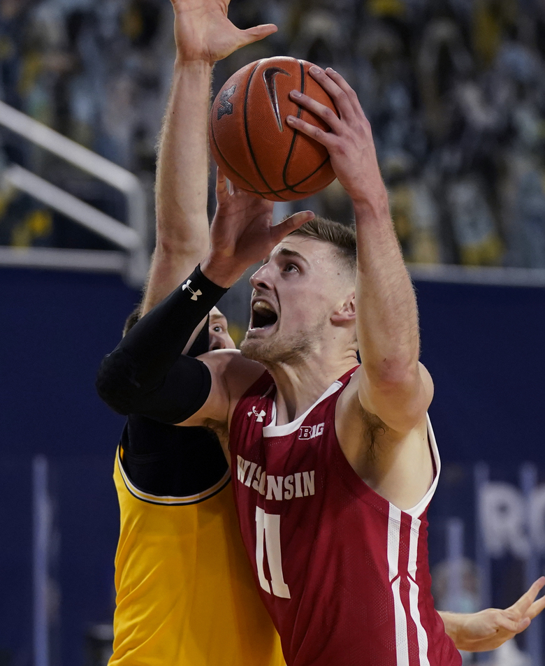 Wisconsin forward Micah Potter (11) attempts a layup during the first half of the team's NCAA college basketball game against Michigan, Tuesday, Jan. 12, 2021, in Ann Arbor, Mich. (AP Photo/Carlos Osorio)