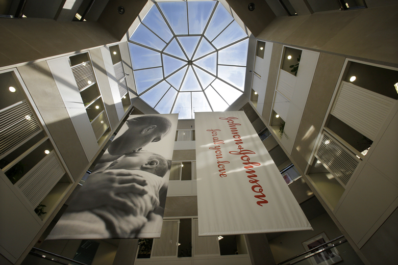 FILE – In this July 30, 2013, file photo, large banners hang in an atrium at the headquarters of Johnson & Johnson in New Brunswick, N.J. Johnson & Johnson's long-awaited vaccine appears to protect against COVID-19 with just one shot – not as strong as some two-shot rivals but still potentially helpful for a world in dire need of more doses.(AP Photo/Mel Evans, File)