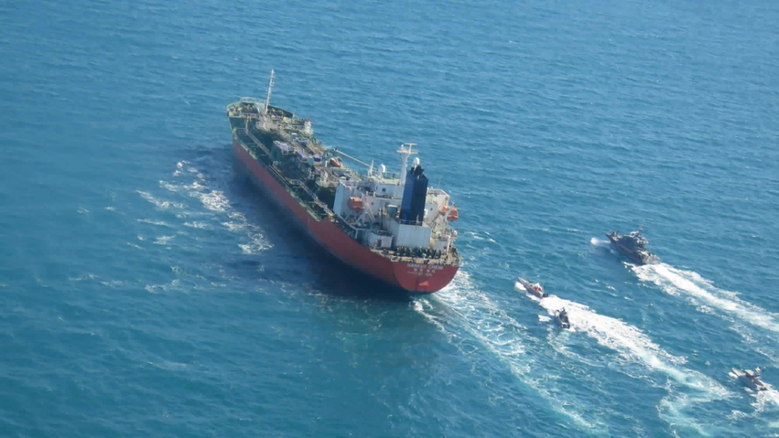 "In this photo released Monday, Jan. 4, 2021, by Tasnim News Agency, a seized South Korean-flagged tanker is escorted by Iranian Revolutionary Guard boats on the Persian Gulf. Iranian state television acknowledged that Tehran seized the oil tanker in the Strait of Hormuz. The report on Monday alleged the MT Hankuk Chemi had been stopped by Iranian authorities over alleged ""oil pollution"" in the Persian Gulf and the strait. (Tasnim News Agency via AP)"