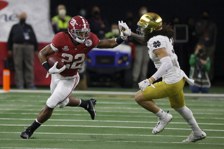 Alabama running back Najee Harris (22) fights off a tackle attempt by Notre Dame linebacker Marist Liufau (35) in the first half of the Rose Bowl NCAA college football game in Arlington, Texas, Friday, Jan. 1, 2021. (AP Photo/Michael Ainsworth)