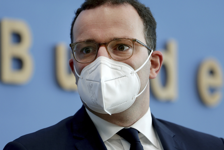 FILE – In this Tuesday, Nov. 3, 2020 file photo, German Health Minister Jens Spahn arrives for a press conference in Berlin, Germany. The coronavirus pandemic is colliding with politics as Germany embarks on its vaccination drive and one of the most unpredictable election years in its post-World War II history. (AP Photo/Michael Sohn, file, pool)