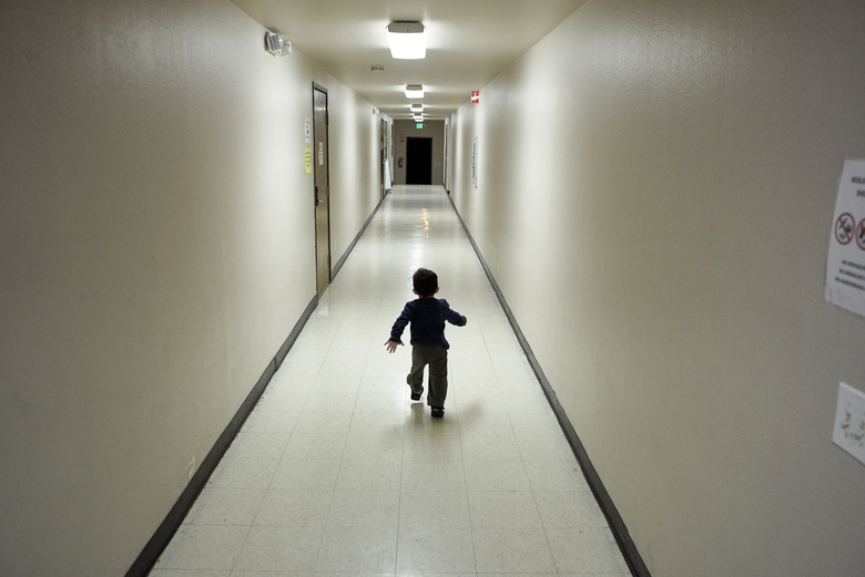 FILE – In this Dec. 11, 2018, file photo, an asylum-seeking boy from Central America runs down a hallway after arriving from an immigration detention center to a shelter in San Diego. A court-appointed committee has yet to find the parents of 628 children separated at the border early in the Trump administration. (AP Photo/Gregory Bull, File)