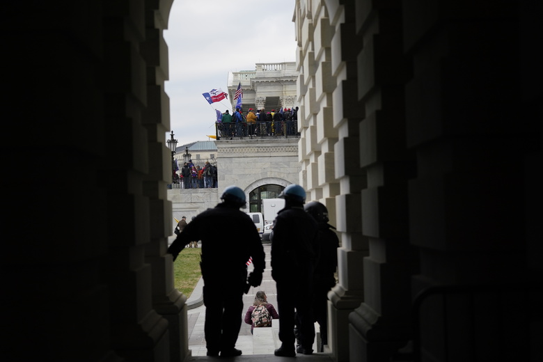FILE – In this Jan. 6, 2021, file photo rioters gather outside the Capitol in Washington. When President-elect Joe Biden takes office later this month, his biggest challenge may be navigating a deeply divided country past the turmoil of the Trump era. (AP Photo/Manuel Balce Ceneta, File)