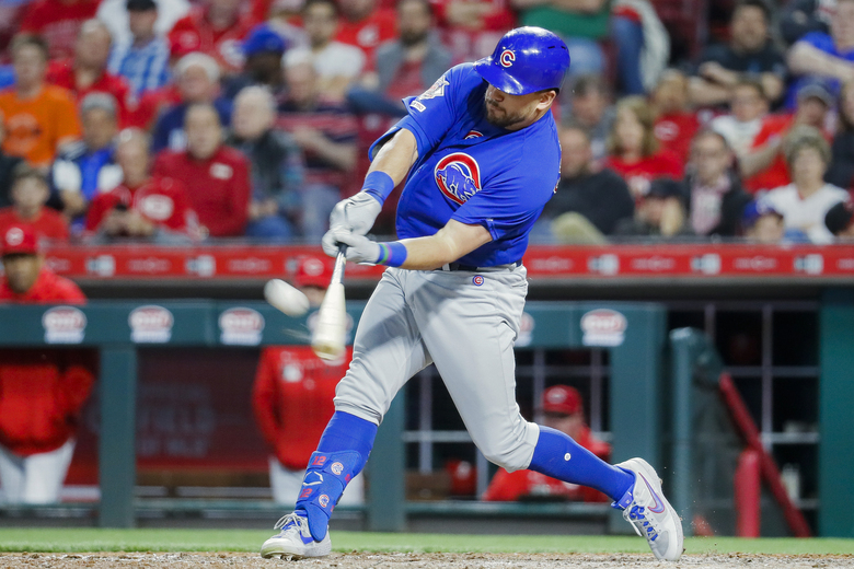 FILE – In this May 15, 2019, file photo,  Chicago Cubs' Kyle Schwarber hits a solo home run off Cincinnati Reds relief pitcher David Hernandez in the eighth inning of a baseball game in Cincinnati. Schwarber agreed in principle to a one-year, $10 million contract with the Washington Nationals, according to a person familiar with the deal. The person confirmed the agreement to The Associated Press on condition of anonymity on Saturday, Jan. 9, 2021,  because a physical exam was still pending for Schwarber. (AP Photo/John Minchillo, File)