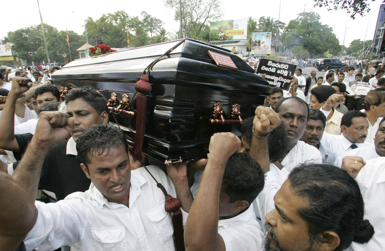 FILE – In this Monday, Jan. 12, 2009, file photo, Sri Lankans shout slogans against the government during the funeral procession of the Sunday Leader newspaper editor Lasantha Wickrematunge, in Colombo, Sri Lanka. The daughter of the slain journalist filed a complaint Friday, Jan. 8, 2021, with the United Nations Human Rights Committee over alleged government involvement in her father's death 12 years ago. The San Francisco-based Center for Justice and Accountability filed the complaint on behalf of Ahimsa Wickrematunge, the daughter of Lasantha, who was allegedly killed by a military-linked hit squad while driving to work on Jan. 8, 2009. (AP Photo/Gemunu Amarasinghe, File)