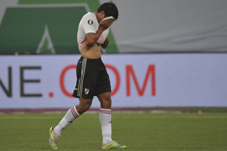 Robert Rojas of Argentina's River Plate leaves the field after receiving a red card during a Copa Libertadores semifinal second leg soccer match against Brazil's Palmeiras at the Allianz Parque stadium in Sao Paulo, Brazil, Tuesday, Jan. 12, 2021. (Nelson Almeida/Pool via AP)