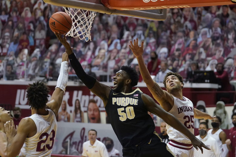 Purdue's Trevion Williams (50) shoots against Indiana's Trayce Jackson-Davis (23) and Race Thompson (25) during the first half of an NCAA college basketball game Thursday, Jan. 14, 2021, in Bloomington, Ind. (AP Photo/Darron Cummings)