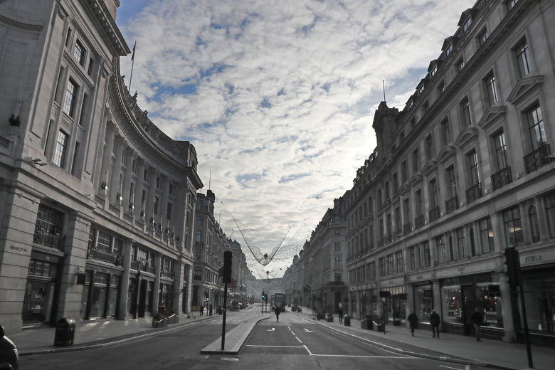 A view of a virtually empty Regent Street in London, Thursday, Jan. 7, 2021. Britain's Prime Minister Boris Johnson has ordered a new national lockdown for England which means people will only be able to leave their homes for limited reasons, with measures expected to stay in place until mid-February. (AP Photo/Frank Augstein)