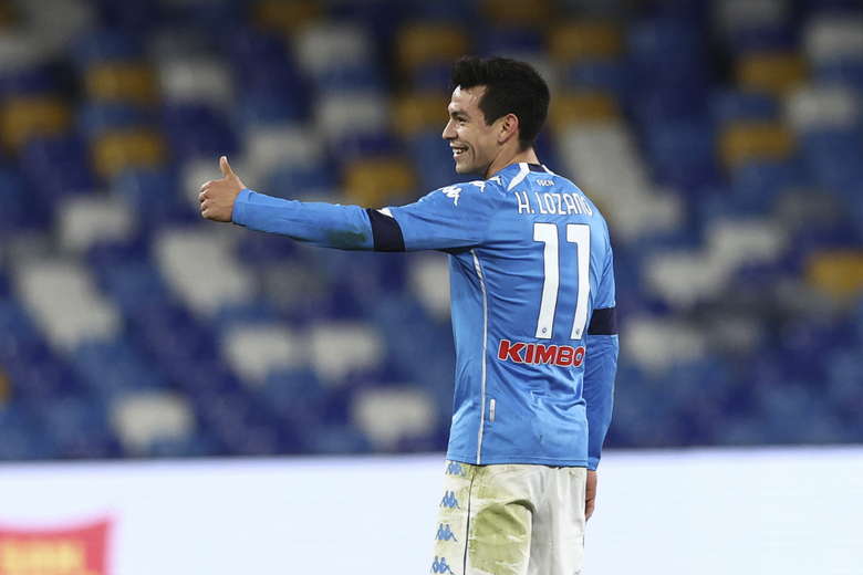 Napoli's Hirving Lozano celebrates after scoring his side's second goal of the game during the Italian Cup, quarterfinal soccer match between Napoli and Spezia at the Maradona stadium in Naples, Italy, Thursday, Jan. 28, 2021. (Alessandro Garofalo/LaPresse via AP)