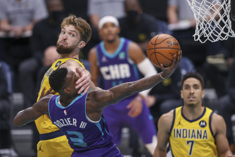 Charlotte Hornets guard Terry Rozier (3) is fouled by Indiana Pacers forward Domantas Sabonis on a drive to the basket during the second half of an NBA basketball game in Charlotte, N.C., Wednesday, Jan. 27, 2021. (AP Photo/Nell Redmond)