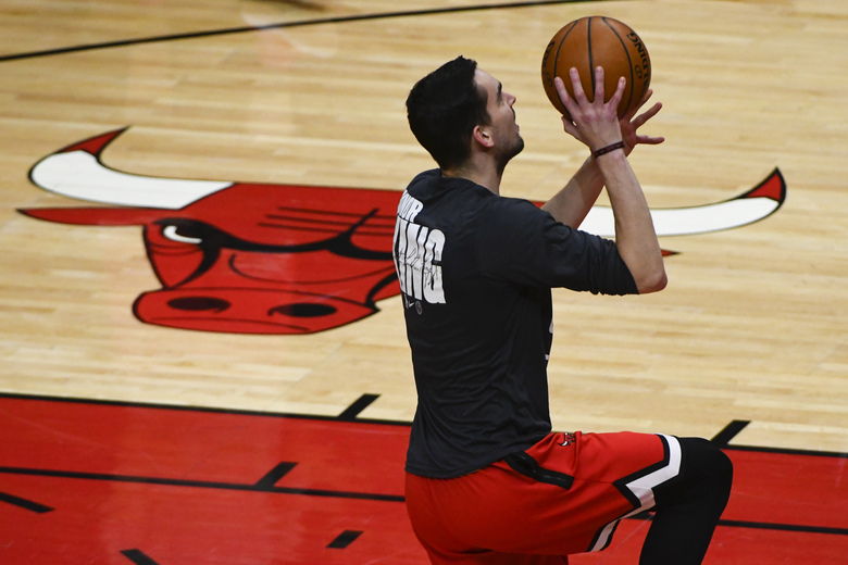 Chicago Bulls guard Tomas Satoransky warms up wearing a shirt that honors Dr. Martin Luther King Jr., before an NBA basketball game against the Houston Rockets, Monday, Jan. 18, 2021, in Chicago. (AP Photo/Matt Marton)